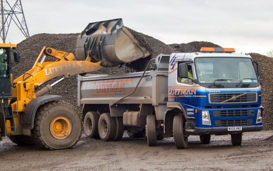 Aggregate loaded onto tipper